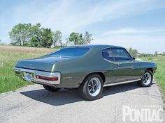 1970 Pontiac Lemans Sport-Mine had two-tone paint with pin striping and a 427 engine.  It could fly.
