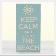 Keep Calm and go to the Beach sign. Hand-painted wood sign in a sky blue hue with cream lettering. Hand distressed for the look of a vintage coastal sign. Hand-made in the USA.