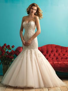 Style 9275. Beaded and lace top with a mermaid train. Allure Bridals wedding dress.
