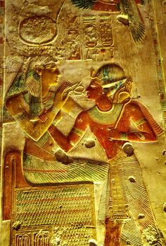 Goddess Auset (Isis) blessing and giving Ankh (life) to King Seti I Abydos Temple