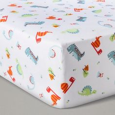 Your little one's imagination will roar with the Dinosaur Roar Crib Bedding Set by Trend Lab. Friendly pre-historic dinosaurs alongside trees, volcanoes and adorable prints mix with a variety of different textures to take your little one on an exciting adventure. Scallop stripes, bones and dinosaur foot prints are showcased in the fun color palette including orange, mandarin red, mint, dusty blue, light green, green, silver and glacier gray. Coordinating Dinosaur Roar accessories ar...