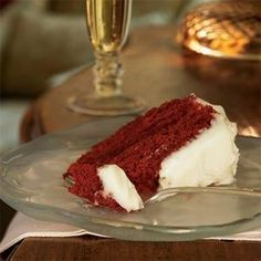Red Raspberry Velvet Cake - Culinary historians believe this originated in New York City in the 1950s at Oscars at the Waldorf-Astoria Hotel. Regardless of its origins, the dessert pairs red-tinted cake with creamy white frosting--a fitting combination for the holidays..  Print this recipe at AmericanFamily.com.