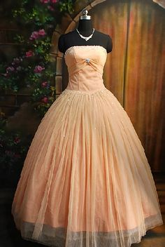 peachy pink  prom/princess dress.... ^-^ (you guys HAVE TO go look at all the prom dresses on the top floor of Dillards! There are so many left and REALLY good deals!!)