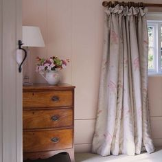 Susie Watson Designs - Susie Watson Designs Fabric Collection - A wood chest of drawers with a clear and white table lamp, a jug vase, and floor-length grey, pink and green floral curtains Country Cottage Bedroom, Cottage Style, Cottage Bedrooms, Country Bedrooms, Pink Bedrooms, Cottage Curtains, Bedroom Curtains, Lounge Curtains, Style Anglais