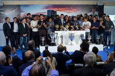 Cristiano Ronaldo poses for a picture with his trophy as all time top scorer of Real Madrid CF lines up with president Florentino Perez and all his...