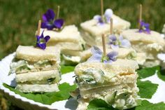 Mini cucumber-paprika tea sandwiches with violets  Makes about 20 stacked minis  1 large seedless cucumber, cleaned but not peeled  8 oz. cream cheese, softened (bring to room temperature while the cucumbers drain)  1/4 cup mayonnaise  1 Tbsp chives, chopped finely (or green onions or mint)  1/2 teaspoon Worcestershire sauce (or lemon juice)  1/4 to 1/2 tsp smoked paprika  Dash of Tabasco  1/4 tsp salt  1/8 tsp freshly ground pepper  20 slices very thin white bread