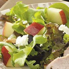 Apple & goat cheese salad... I would use craisins and pecans instead of raisins & walnuts.