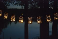 Perfect for lighting up the night at a cottage wedding. Click through for a step-by-step on how to make them. Skip the tealights - se battery operated LEDs to make them safe. Mason Jar Lanterns, Mason Jar Lighting, Jar Candles, Jar Lights, String Lights, Hanging Lights, Deco Led, Diy Wedding Reception, Wedding Ideas