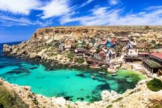 Beautiful villages around the world. famous popeye village in malta Amazing Places On Earth, Beautiful Places In The World, Beautiful Places To Visit, Places Around The World, Travel Around The World, Places To See, Around The Worlds, Destination Voyage, Vacation Places