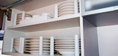 Tips: 10 RV storage ideas-News & Reviews-Caravan World. dishes held in place with wooden pins that are screwed in. perhaps doorstops would work.