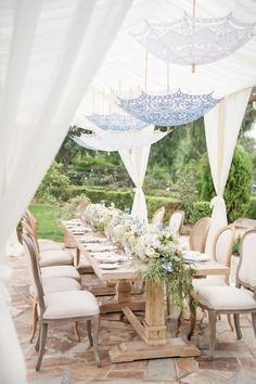 Vintage parasols that are inexpensive to get yet looks so sophisticated. They can replace those outdoor chandeliers that cost a fortune.