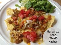 """New Nostalgia: Healthy Nachos  Uses roasted chickpeas as the """"meat""""  They are delicious! #nachos #chickpeas #vegan"""