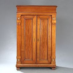 Thorvald Bindesbøll, (b. Copenhagen 1846, d. s.p. 1908)  Mahogany cabinet, Made by cabinetmaker J.P. Mørck. H. 183 cm. W. 117 cm. D. 53 cm.    Displayed at The World Exhibition in Paris, 1900.    Due to the cabinet being designed for The World Ehhibition, it was made in only 11 parts for easy assembly with just four wedges.