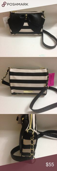 """Betsey Johnson Crossbody Bow Black/White Purse Authentic new with tag Betsey Johnson Crossbody bag. H: approx. 7"""" L approx. 10"""". It is white with black stripes and a black bow on the front. Smoke Free and Pet Free Environment. Betsey Johnson Bags Crossbody Bags"""