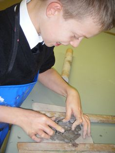 Nathan W making one of his clay Christmas Tree decorations