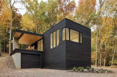 Tinkerbox by Studio MM Architect, Hudson Valley retreat, charred cedar siding for homes, charred cedar home, Hudson Valley guesthouse, mahogany pivot door,