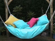 Meet Le Beanock, an oversized indoor/outdoor hammock and beanbag mashup. It's made with indoor/outdoor (mildew-proof) fabric and beans, designed to be suspended from all four edges like a big hammock, and comes in all kinds of fun colors Backyard Hammock, Outdoor Hammock, Hammock Chair, Hammocks, Hammock Ideas, Indoor Outdoor, Diy Hammock, Hammock Stand, Hammock Bathtub