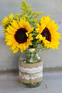 Sunflowers and Lace Arrangment: Nothing says summer like a sunflower. Go the extra mile by adding burlap and lace. Click through to find more pretty mason jar flower arrangements to try this summer.