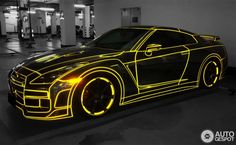 This incredible looking Nissan GT-R has been outlined with fluorescent tape outlining every crease, curve and ridge of Godzilla.