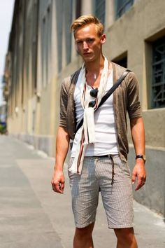 so here we go very effortless look for a guy. shorts, cardi scarf all in similar color tones and of course summer time must sunglasses! {u}