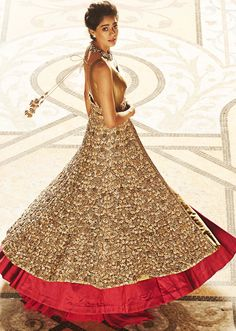 Long jacket lehenga in beige and gold enahnced in beads and sequin embroidery only on Kalki