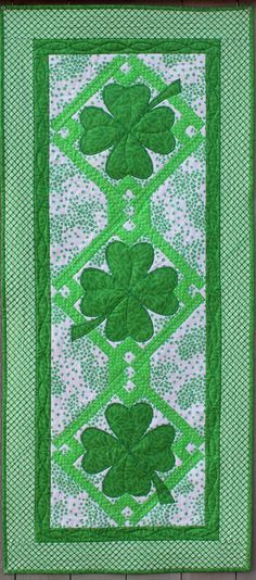 Welcome Spring and celebrate St. Patrick's Day with this lucky quilted table runner and placemat set.