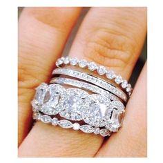 We love @emilygmaynard's Henri Daussi stack #love #diamonds #engaged