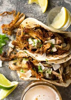 (Mexican Slow Cooker Pulled Pork) Overhead photo of two Pork Carnitas Tacos with tequila shots on the side.Overhead photo of two Pork Carnitas Tacos with tequila shots on the side. Pork Carnitas Tacos, Pork Carnitas Recipe, Pulled Pork Tacos, Slow Cooker Pork Carnitas, Mexican Pork Tacos, Authentic Mexican Tacos, Mexican Pulled Pork, Pork Tenderloin Recipes, Clean Eating Snacks