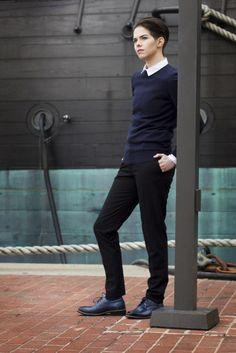 collared shirt, dark sweater + pants, black oxfords