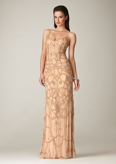 MIGNON Spring / Summer 2014  Elegantly beaded long dress featuring intricate designs and spaghetti straps.  Available in colors: · Facepowder, Vanilla