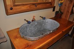 sunken galvanized sink, my dad said i was crazy when i told him i wanted a bucket for a sink, i just love it tho lol