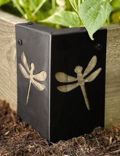 Deco Raised Bed Corners from gardeners.com in Fiddlehead or Dragonfly designs. Good for shoring up old raised beds.