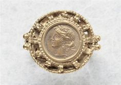 Ring: gold coin from Carthage with horse and head of Ceres -  3rd century. Ancient Rome (Period). | Louvre Museum.