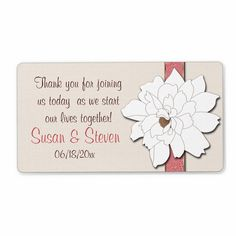 Magnolia Dreams Favor Sticker  Part of our Magnolia Dreams collection is this beautiful label that is perfect to add to your wedding favors. The background is a pale cream that is digitally textured to have the appearance of burlap, this is then accented with a beautiful floral patterned ribbon in a pretty deep coral and a large white magnolia blossom. Customize it with the text of your choice, add the names of the bride and groom along with your wedding date.