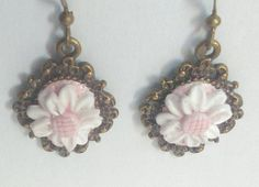 Items similar to Daisy Earrings Daisy Dangle Earrings Antique Bronze Filigree Cabochon Handmade Polymer Clay Daisy Pastel Goth Earrings Costume Jewelry on Etsy Antique Earrings, Dangle Earrings, Daisy, Dangles, Brooch, Pearls, Antiques, Trending Outfits, Unique Jewelry