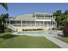 """932 Allegro Ln, Apollo Beach, FL 33572 — """"Wow"""" is the comment you will hear the moment your guests enter this lovely 2 story, pool home and notice the great water views of the widest,  deep, saltwater canal in town.  The large master suite is located downstairs, has French doors that open onto a long and wide covered, screened porch with views of the pool area and the saltwater canal. The master bath has a separate commode area, large walk-in shower, two vanities, and plenty of closet space…"""