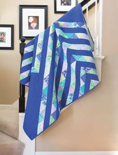 Shelley Cavanna's inspiration for this quilt came from the rolling ocean waves along the beautiful coastline of Scotland. She aptly used sea glass shades of blue and green for the triangles. Learn how to make Selkie in our free video tutorial.