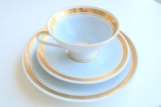 VINTAGE tea / coffee set saucer plate cup GOLD and blue GERMAN. €12,00, via Etsy.