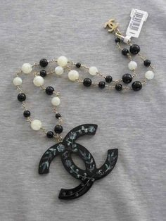 Chanel Oversize CC Logo Mother of Pearl Beads Ecru Black Gold Chain Necklace