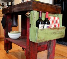 DIY Pallet Kitchen Island: Beyond The Picket Fence This kitchen island made from recycled shipping pallets is gorgeous! I love all the colours used. Total DIY envy over here. Click the photo for more amazing photos.