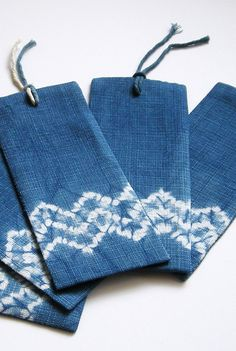 Hand dyed bookmarks; stationery accessory for a tiny little gift. Natural indigo Mokume shibori bookmarks by Little m Blue.