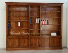Libreria smontabile in noce massello con 5 ante e vani a giorno, ripiani spostabili, libreria in stile classico.