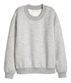 Gray melange. Soft sweatshirt with dropped shoulders, long sleeves, and ribbing at neckline, cuffs, and hem. Soft, brushed inside.