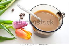 Coffee cup and tulips on white background. Spring flowers and coffee beans. #coffee #spring #flower