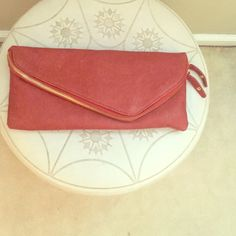 Coral Clutch Gorgeous deep coral clutch with removable gold strap. Can function as a clutch or over the shoulder bag. Has a main pocket and a zipper pocket on the top of the bag. Has only been used twice! Bags Clutches & Wristlets