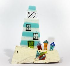 Blue Lighthouse with Driftwood - Medium by Nadia Lammas. Available from Artworx Gallery www.artworx.co.uk