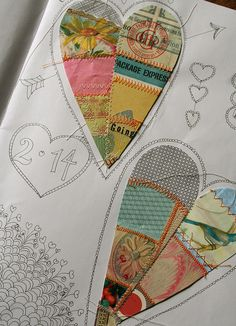 collaged hearts in an art journal
