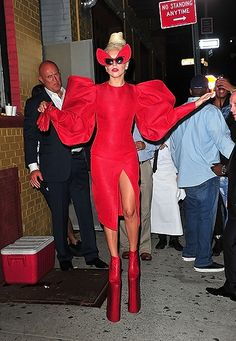 Lady Gaga walks in skyscraper heels while wearing a red ensemble in the Meatpacking District in NYC.
