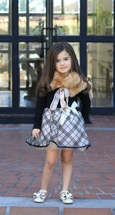 The attitude, the right dress and fur caplet can give you a crown! Find this adorable look at Bowties and Tutus Boutique.