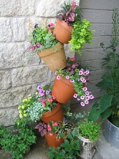 tiered wooden plant stands outdoor | front yard landscaping ideas